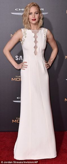 Peek-a-boo: The star showed a hint of skin in a floor-length gown which featured small, sheer panel along the front