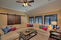 Barn Doors and Navy Shutters - Oh My!!  What a great look for a family room.
