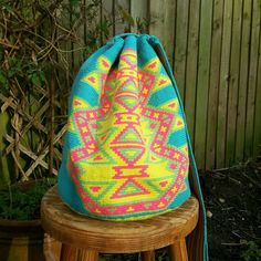 Wayuu mochila bag from Colombia ~ this a cross body, drawstring closure, handmade bag made by a woman of the Wayuu tribe in La Guajira, Colombia. Made using the 'una hebra/1-thread crochet technique, this guarantees the finest quality! A perfect bag for the summer!