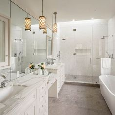 Contemporary Master Bathroom with frameless showerdoor, Rain Shower Head, Handheld Shower Head, Flat panel cabinets, Flush