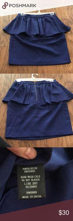 Royal blue peplum mini Rot blue peplum mini. Zips up the back Gianni Bini Skirts Mini