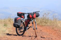 vintage steel mountain bikes from the and make excellent touring bikes. This guide explains how to convert an old mountain bike into a touring bike. 26 Inch Mountain Bike, Mountain Bike Trails, Hiking First Aid Kit, Bikepacking Bags, Running Humor, Touring Bike, Bike Reviews, Old Bikes, Run Disney