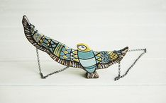Hey, I found this really awesome Etsy listing at https://www.etsy.com/listing/152086686/bird-necklace-wood-necklace-yellow-and