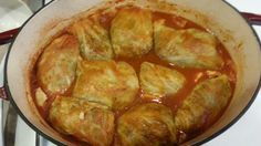 Stuffed cabbage-ground beef, rice, sauteed onion, garlic, salt & pepper. Rolled in steamed cabbage leaves. Chop remaining cabbage for bottom of dutch oven, place rolls on top, cover with Original V8, bake at 350° for 1 hour....Yummy!