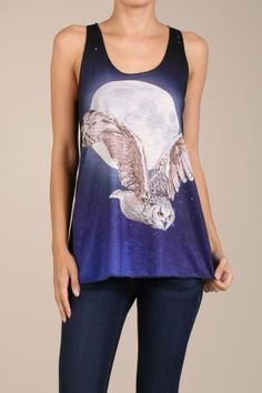 Fly to the moon and back in this beautiful racer back tank top.  Rich black and blue colors with a beautiful full moon and starry night scene this top features a dramatically detailed image of a snowy owl in flight.  A wonderful top for those warm summer nights.    FIT NOTE: This top runs just a little small.