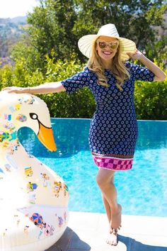 Reese Witherspoon wearing Draper James Harding Hillsboro Shift Dress and Funboy Gray Malin Pool Float