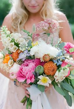 You don't have to be a classic bride to love peonies. This wild bouquet, created by Denver-based florist Lalé Florals, features peonies, garden roses, ranunculus, poppies, protea, sweet peas, scabiosa pods, dahlias, and air plants. What's not to love?