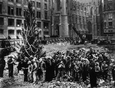 The first Rockefeller Center Christmas tree, in 1931, with Saks Fifth Avenue and St. Patrick's Cathedral right across the street