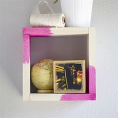 Using dye pigments and scrap wood, you can dip dye wood pieces and join them together to form a display shelf perfect for a small vignette.