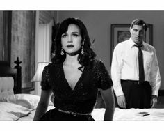 Still of Carla Gugino and Rufus Sewell in Hotel Noir