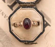 Victorian 19th C. 10K Gold Garnet Cabochon Ring with lovely shank detail. Engraved PHS '98.