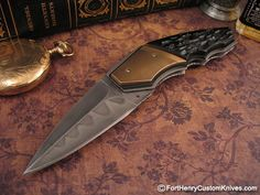 Corrie Schoeman. This is a very elegant linear designed Gentleman's knife called the Xecute. Available from Fort Henry Custom Knives