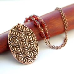 Hypnotic pattern oval necklace, 7th anniversary copper gifts, 2nd anniversary gift, metal clay copper jewelry, handmade garnet jewellery