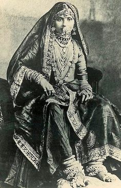 Here's something we don't see on a modern Indian Bride; dressed from top to toe in fine jewellery probably consisting of precious stones, pearls, gold and silver. I'm not sure how far back this picture dates to but from looking at it, probably late 19th Century.