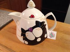 Kitty teapot and the lady bug