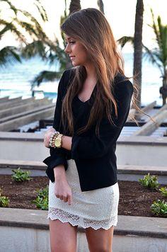 black blazer black top and white skirt