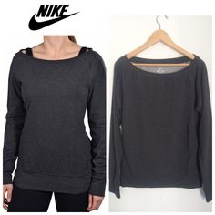 NWT Nike Dri Fit Off The Shoulder Longsleeve ACCEPTING OFFERS!!. No low ballers. No trades. New with tag. Dark grey. Dri fit material. Size small but oversized. No flaws or stains. Dress casual with jeans or Cute with leggings and sneakers. Retail $64 Nike Tops Tees - Long Sleeve