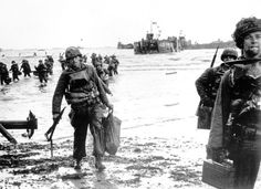 Carrying full equipment, American assault troops move onto a beachhead code-named Omaha Beach, on the northern coast of France on June 6, 1944, during the Allied invasion of the Normandy coast.
