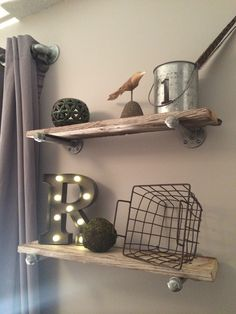 Woodland nursery. Industrial shelves. Barn wood and galvanized pipe. Marquee letter.
