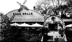 Oslo Restaurant Den Røde Mølle i Tivoli var inspirert av franske Moulin Rouge og introduserte jazzmusikk for publikum i Oslo. Foto av inngangspartiet fra ca. 1930. Foto Ernst Rude