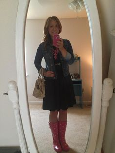 Perfect look for a rainy day.Black dress and denim jacket with pink statement necklace. Love the pink rain boots.