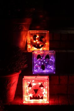 Glass block Jack-o-lanterns.  So easy to make!  I made an orange one this afternoon.  All you need is a glass block, lights, and foam.