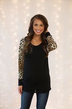 The Pink Lily Boutique - Black Animal Print Sleeve Blouse, $32.50 (http://thepinklilyboutique.com/black-animal-print-sleeve-blouse/)