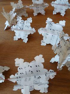 Christmas Paper Snowflake Garland by lauradawnhiggins on Etsy, $9.50