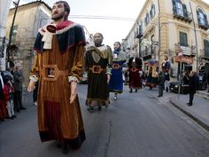 March 31, 2013. Sampauluna are giant statues which are carried during a Easter procession in San Cataldo, Sicily. The giant papier-mache characters represent the eleven apostles, excluding Judas.
