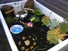 Children's fairy garden in old belfast sink. Fun outdoor small world play in early years. Belfast Sink Water Feature, Belfast Sink Garden, Outdoor Play, Outdoor Ideas, Butler Sink, Small World Play, Water Features, Fairy Gardens, School Ideas