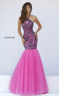 Lace on lace is lusciously inviting in the Sherri Hill 50015 halter neck prom dress. The elongated lace bodice cleaves to the curves and is styled in lace, embellished with delicately beaded bold lace appliques. It features an illusion halter neckline, dropped waistline and semi-open back. The trumpet skirt flares in fabulous layers of frothy tulle to finish in a filmy sweep train.