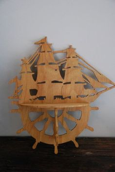 Vintage Wooden Nautical Shelf. $32  http://www.etsy.com/listing/91347020/vintage-wooden-nautical-shelf
