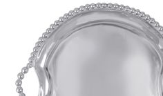 Pearled Round Handled Tray | Lucky Den | Mariposa has a gift for tradition reimagined in the String of Pearls collection. A multitude of pearls provide whimsical handles and a luxurious border around the simple, yet elegant, Round Tray. Tray curves slightly at edges for serving without the spills.