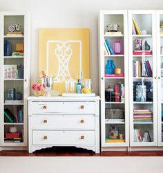 Crisp white painted bookcases and display cases make your colorful collections pop.  Try Snow White from General Finishes on a Whittier Wood Products display case.