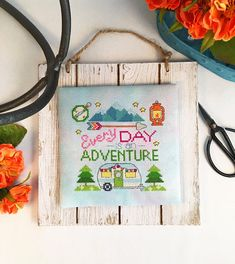 Stitch this very cute saying, Every Day is an Adventure, with retro camper, mountains and trees, compass, and lantern. The cover model was stitched on April Showers 28-count Jobelan fabric by Hand Dyed by Stephanie.  To FFO - I flat-finished it, and attached it to a pre-purchased wooden