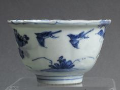 A charming finely-potted and translucent small Chinese deep cup with everted rim, dating from the late Ming Wanli period. An interesting cup, with the body moulded into the vertical panels typical of kraak wares but decorated in a freer style which does not follow the moulding of the body.  These cups with the bird standing on a rock in the interior are known as 'crow cups' in the Netherlands.