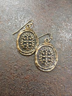 These unique earrings feature replicas of a rustic bronze spanish coin. Love the rustic vintage style and sure to become your everyday favorite