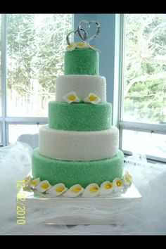 The green layers look like gumdrops! #weddings #weddingcakes