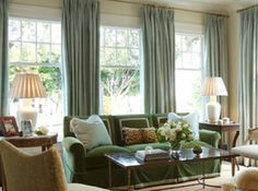Curtains for big windows....I like how they've used the curtains to make it look like 3 separate windows