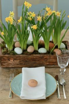 Easter table setting - love the eggs, daffodils and rustic wood planter