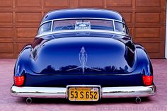 """""""All my friends drive a low rider."""" That song ran thru my mind when I saw this fabulous car."""