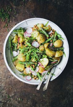 Spring Celebration Salad1 1/2 lb / 800 g new potatoes 2 bunches (1 lb / 500 g) asparagus 1 cup / 100 g sugar peas 1 cup / 175 g cooked whole lentils, rinsed (we used green/brown but any color is fine) 1 small handful chives 5 radishes, very thinly sliced 2 tbsp organic unfiltered apple cider vinegar mustard 1 spring onion, very finely chopped salt & black pepper