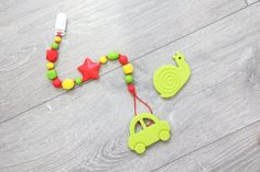 Silicone teether with a pacifier clip with teething от TeetherLand