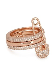 APM Monaco rose gold-plated sterling silver ring Tiered design, safety pin and pavé white zirconium crystal embellishments Presented in…