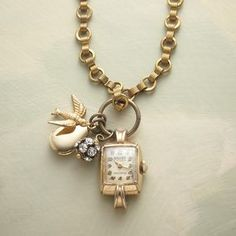 "From Sundance Catalog TRINKET WATCH NECKLACE   Modeled on the allure of antique charm bracelets, our handcrafted brass pendant necklace jingles with a one-of-a-kind vintage watch amidst a bevy of beautiful brass-plated baubles and Swarovski crystals. 26""L."