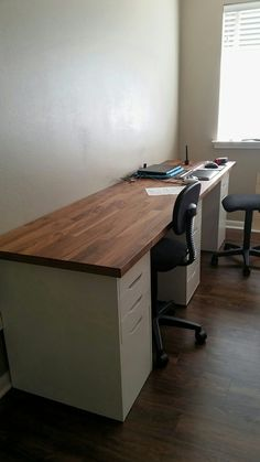 "Desk in craft room is 98"" Ikea Karlby countertop in walnut plus 3 Alex drawer units (2 with drop file)"