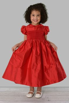 Scarlett is made of 100% Dupioni Silk. Intricate hand-smocked bodice, hand-embroidered details, and satin piping details will make your daughter feel as though she is the princess of the holiday season. For a younger sister you can pair this dress with our Rose dress.  www.savannahchildren.com