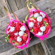 "Dragon fruit ""bowls"" filled with dragonfruit, strawberries, & pomegranate 