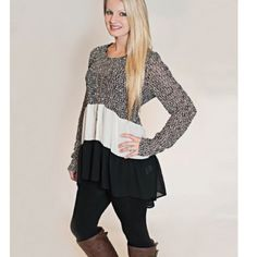 Tunic shirt or dress xl black and white Absolutely gorgeous tunic shirt or dress great with Leggins.  XL  Shoulders.             14.6 inch  Sleeve                    23.8 inch  Chest.                     38.2 inch  Center back length 28.9 inch Boutique Tops Tunics