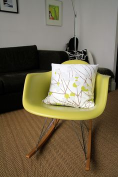 Lime-green Eames rocker with Marimekko pillow.